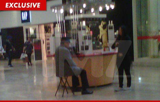 Joe Jackson selling perfume at the Julian Rouas Paris kiosk