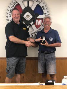 Rob Knoerdel receives a retirement watch from President Howard Ferguson
