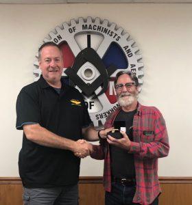 Dan Murphy receives a retirement watch from President Howard Ferguson