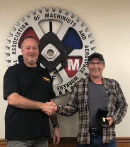 Greg Close receives a retirement watch from President Howard Ferguson