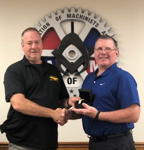 Bob Maltony receives a retirement watch from President Howard Ferguson