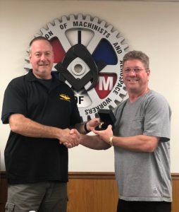 Ted Vallandingham receives a retirement watch from President Howard Ferguson