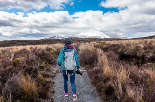 woman walking in cold weather out in nature for exercise