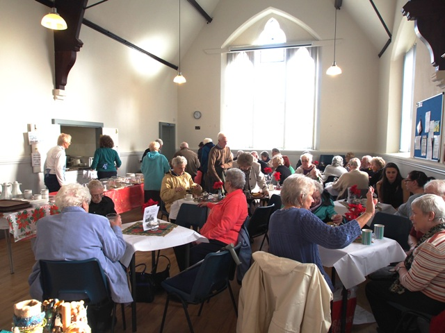 A church fair in progress in the church hall