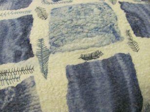 Felted and embellished cushion
