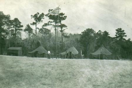 Recon Co.'s Bivouac at Traps Bay, 1952. Garcia near flag pole