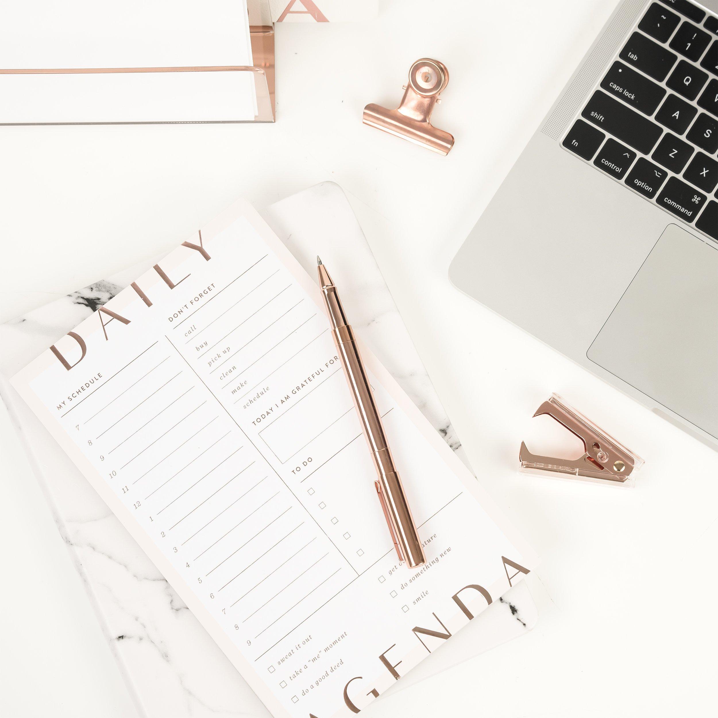 calendar, pen, clips and laptop for web design