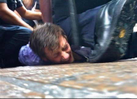 Occupy Wall Street man on ground being arrested 05