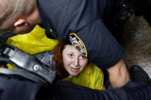 Occupy Wall Street woman on ground being arrested 01
