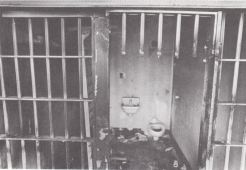 Historical photo Santa Fe Old Main prison torched bars on cell