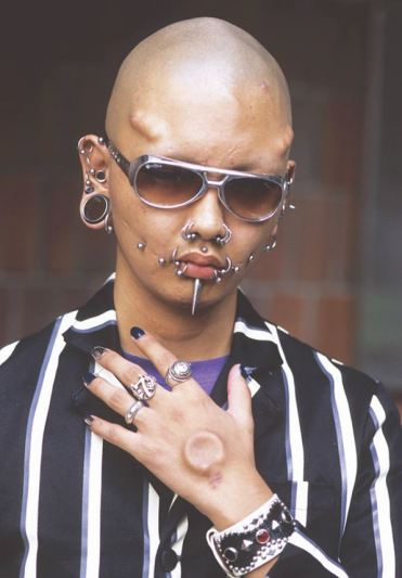 Man showing his body modifications Japan 2