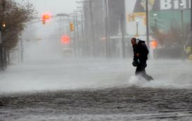 Michael Wirtz, of Wilmington, Del., braves flood waters and high winds that arrive with Hurricane Sandy along North Michigan Avenue in Atlantic City, N.J., Monday Oct. 29, 2012. (AP)