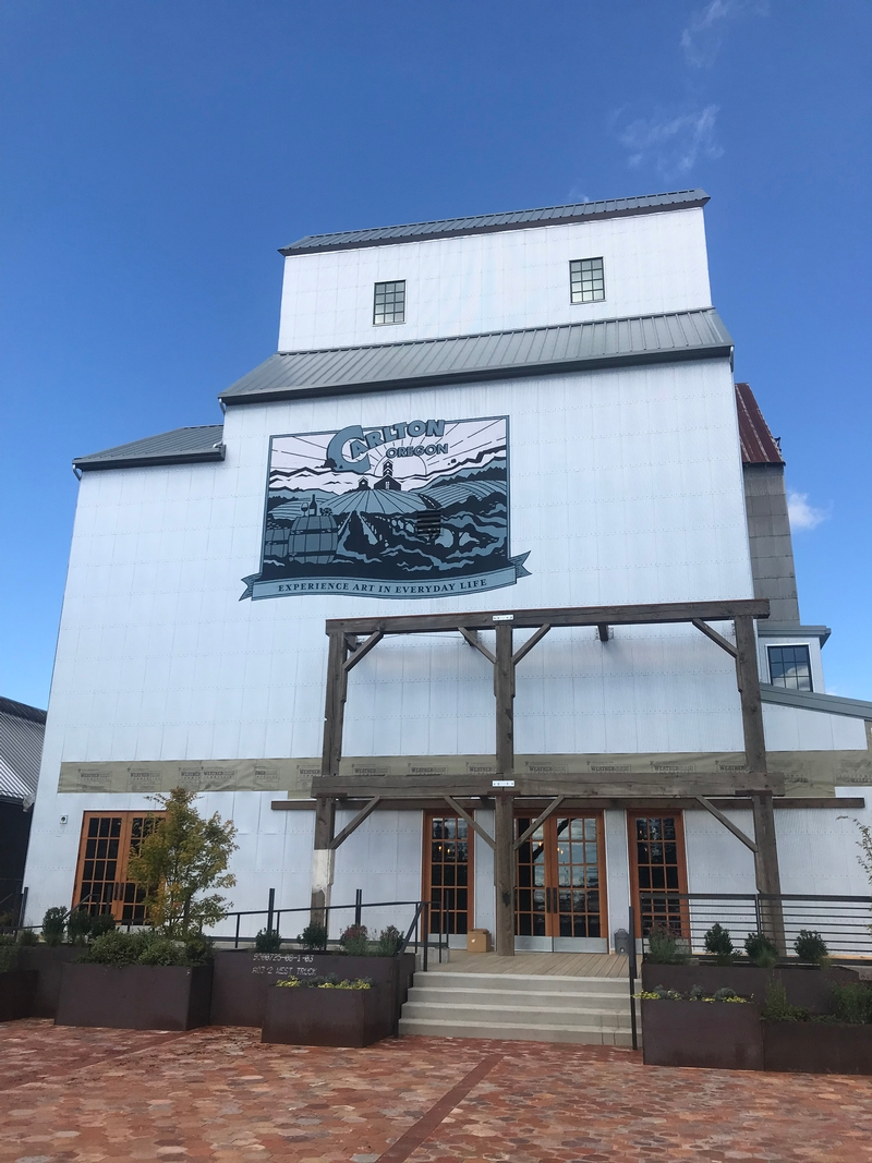 Flâneur Winery Exterior wooden frames and hand-painted mural by Anthony Kuenzi of Kuenzi Design for Flaneur Wines at the Carlton Grain Elevator. ©LMArcher