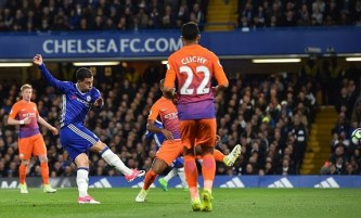 Eden Hazard puts Chelsea ahead with a deflected first-time strike. Image from: Getty