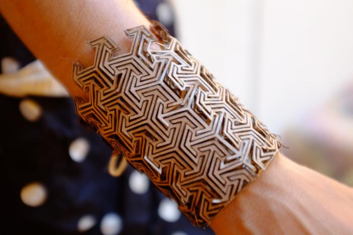 Laser cut cardboard bracelet.