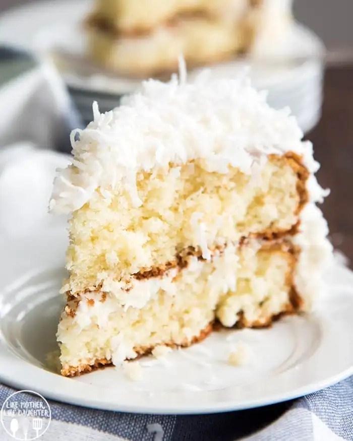 This coconut cake starts with a doctored up cake mix, topped with a homemade coconut syrup, coconut frosting, this cake is irresistible for coconut lovers all spring and summer long!