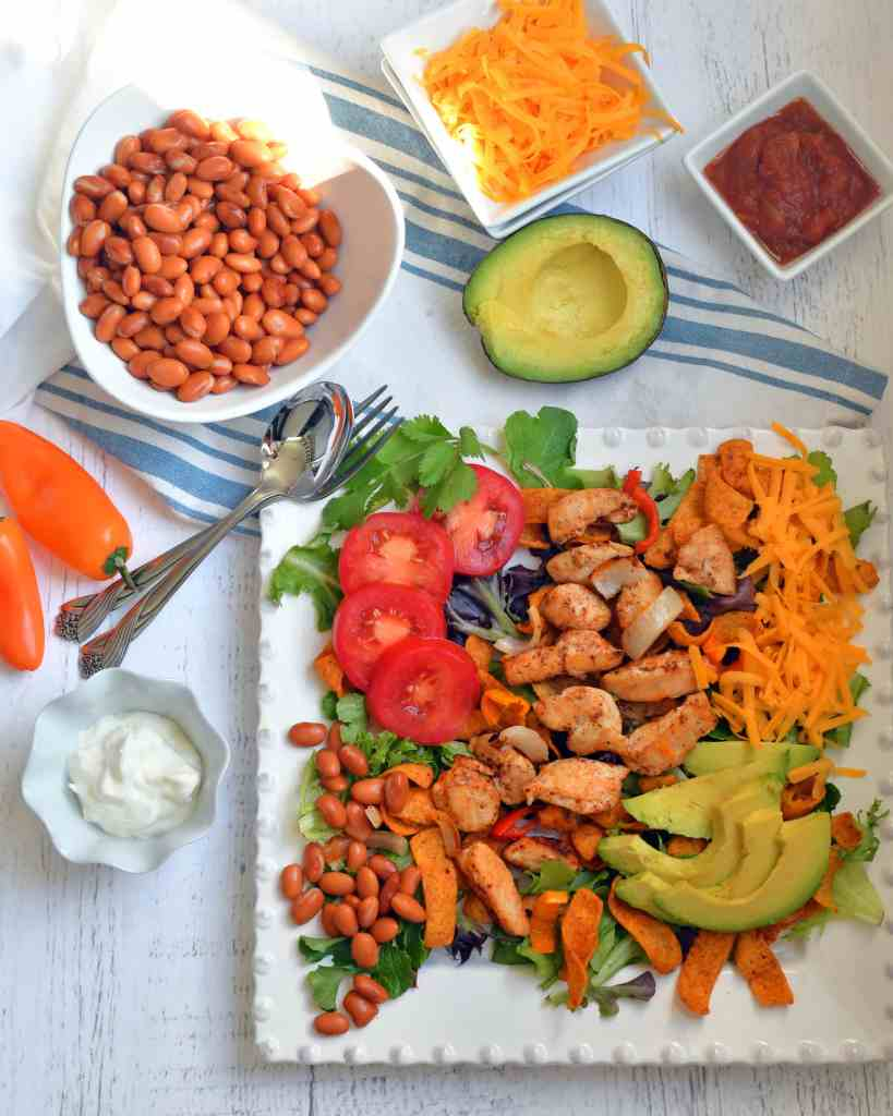 In 30 minutes or less you can have a healthy chicken taco salad with all the fix in's of lettuce, cheese, beans, tomatoes, onions, peppers, and taco chips. Add toppings of sour cream, salsa, avocado, olives, or cilantro.