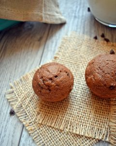 Chocolate zucchini muffins are doubly good with double chocolate of cocoa powder and chocolate chips, and of course grated zucchini. There is no added oil, applesauce is used instead. There is no added sugar, honey is used to sweetened. This is a healthy muffin just perfect for breakfast or snacking.