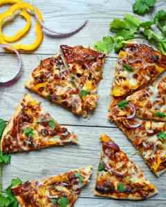 BBQ sauce, sweet peppers, red onions, chicken all a top homemade pizza crust for a BBQ chicken pizza that will have you coming back for more.