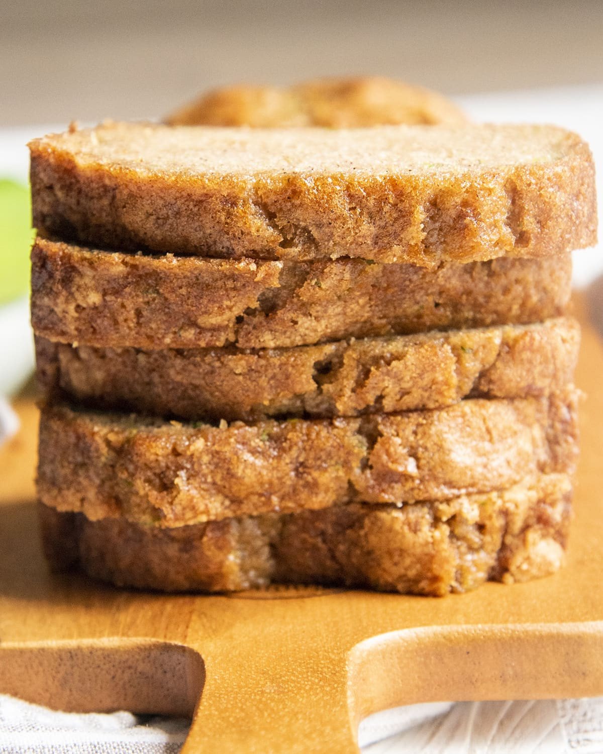 A stack of 5 slices of zucchini bread on top of each other.