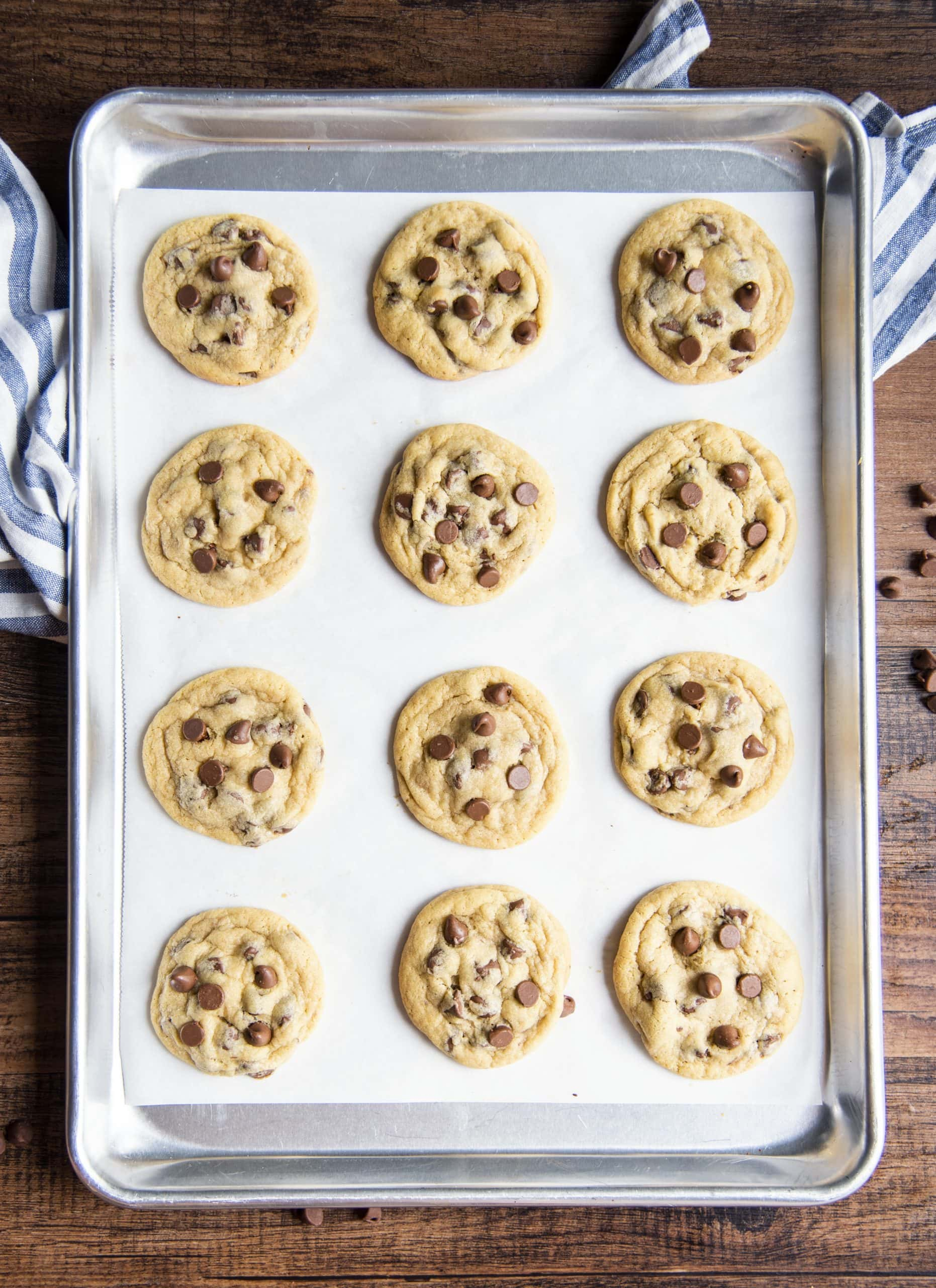 A pan of chocolate chip pudding cookies on parchment paper.