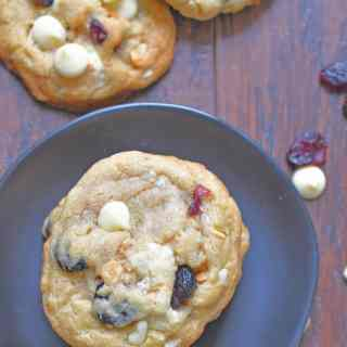 This flavorful and colorful cookie is stuffed full of creamy white chocolate chips, crunchy macadamia nuts, and tart cranraisins for delicious white chocolate, macadamia nut, cranberry cookies.