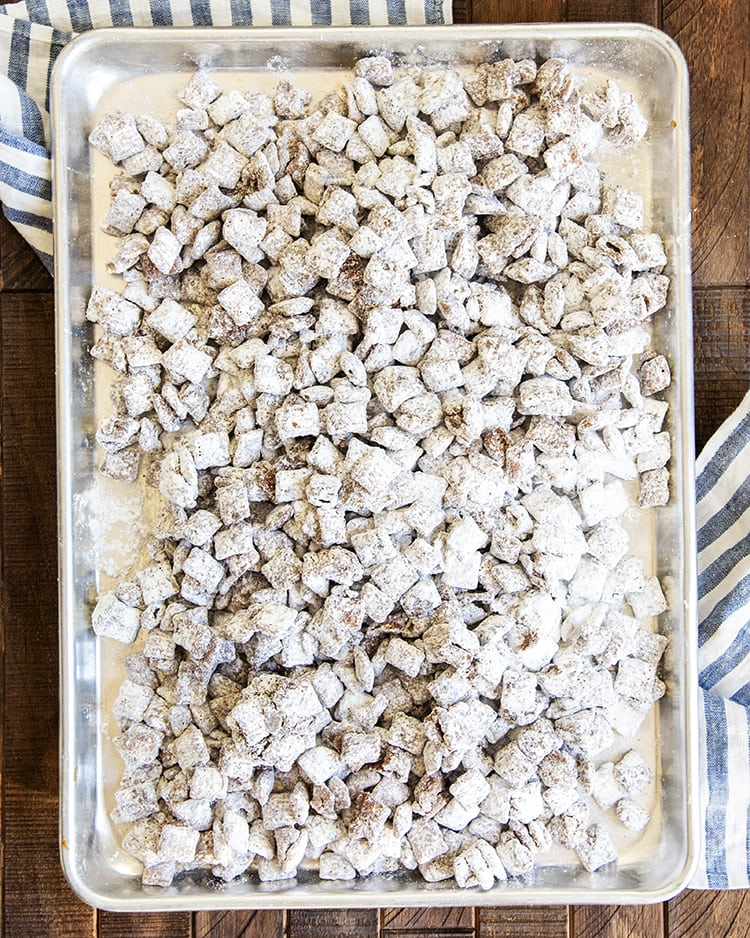 An overhead shot of a baking pan covered in chex cereal.