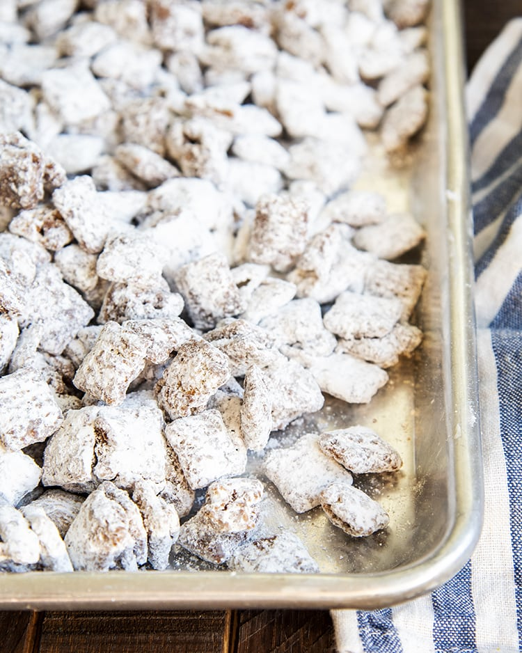 A pan full of muddy buddies made of chex cereal.