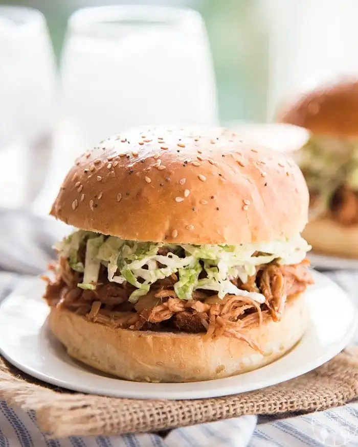 BBQ Pulled Pork is cooked in the slow cooker, with only 7 ingredients, for an easy recipe with almost no prep work that is perfect for pulled pork sandwiches, nachos, salads, and more!