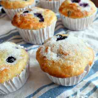 These blueberry coconut orange muffins are moist and delicious with a delightful flavor combination of fresh blueberries, shredded coconut, and orange zest.