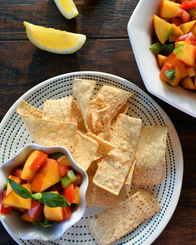 Grilled Peach Salsa is a sweet salsa that is perfect with chips, tacos, or whatever you love salsa on. Grilling the peaches brings out even more sweetness and flavor.