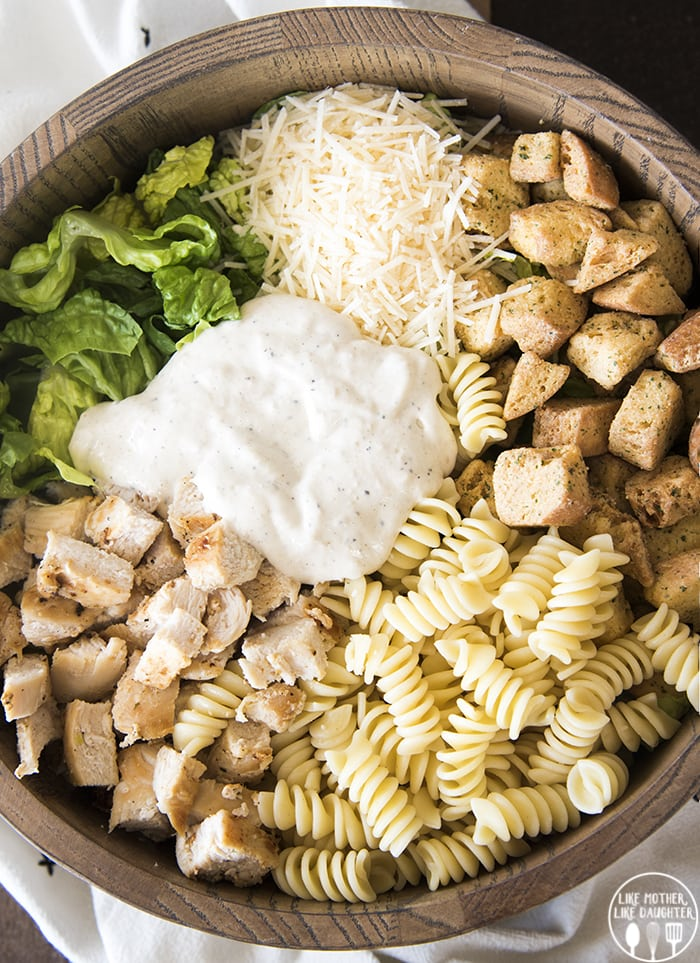 Chicken Caesar Salad with pasta is a delicious mix of pasta salad and chicken </em><em>Caesar salad and is perfect for lunch or a light dinner!