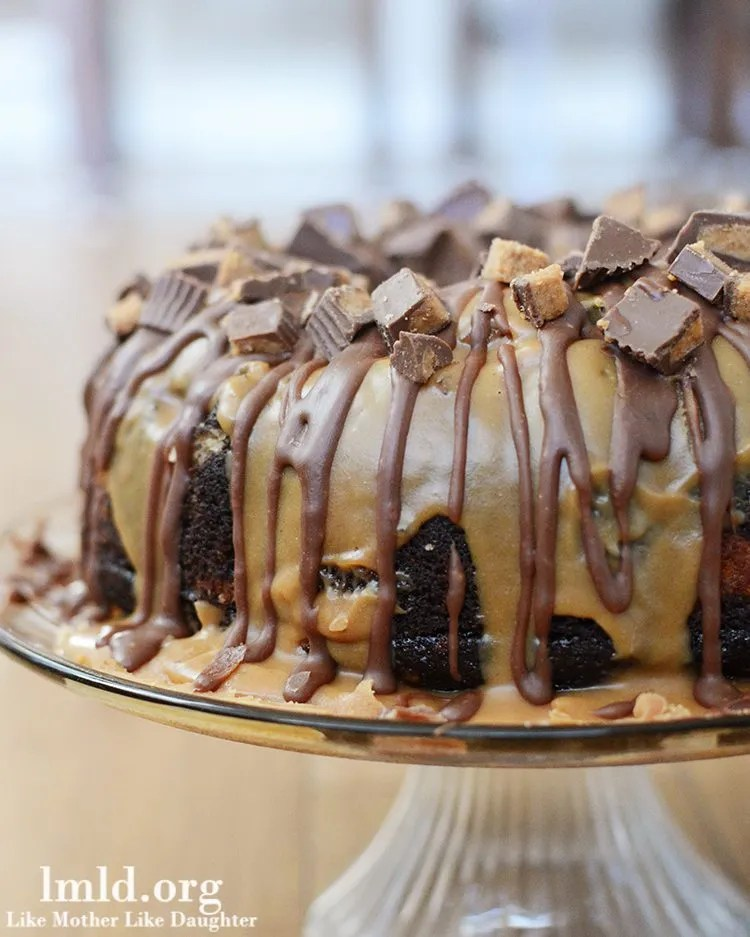Chocolate Peanut Butter Bundt Cake - This amazing chocolate peanut butter bundt cake has a chocolate batter and a peanut butter batter baked and topped with a chocolate ganache, and a peanut butter ganache, all topped with chopped reeses. Its the perfect cake for chocolate and peanut butter lovers in your life!