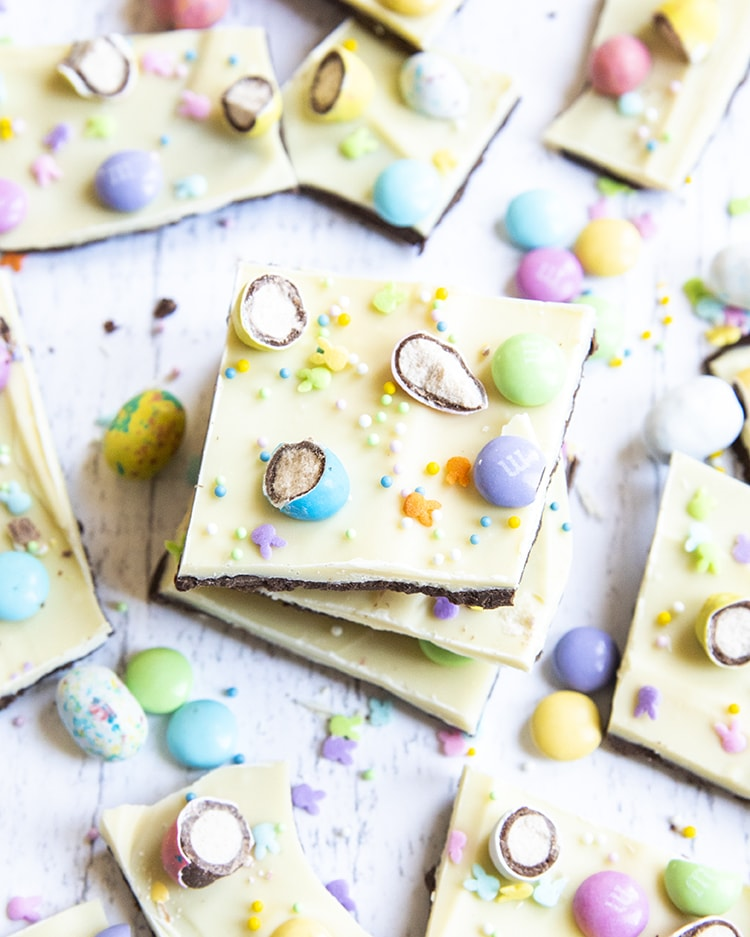A stack of Easter bark from above, with layers of chocolate, white chocolate, and topped with Easter candies.