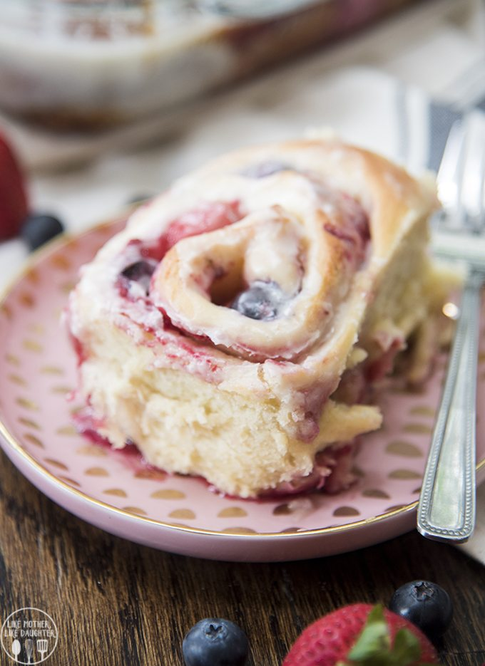 Mixed Berry Sweet Rolls - These sweet rolls are soft fluffy rolls full of frozen raspberries, blueberries and strawberries and topped with the best vanilla icing. These are great for breakfast, brunch or dessert!