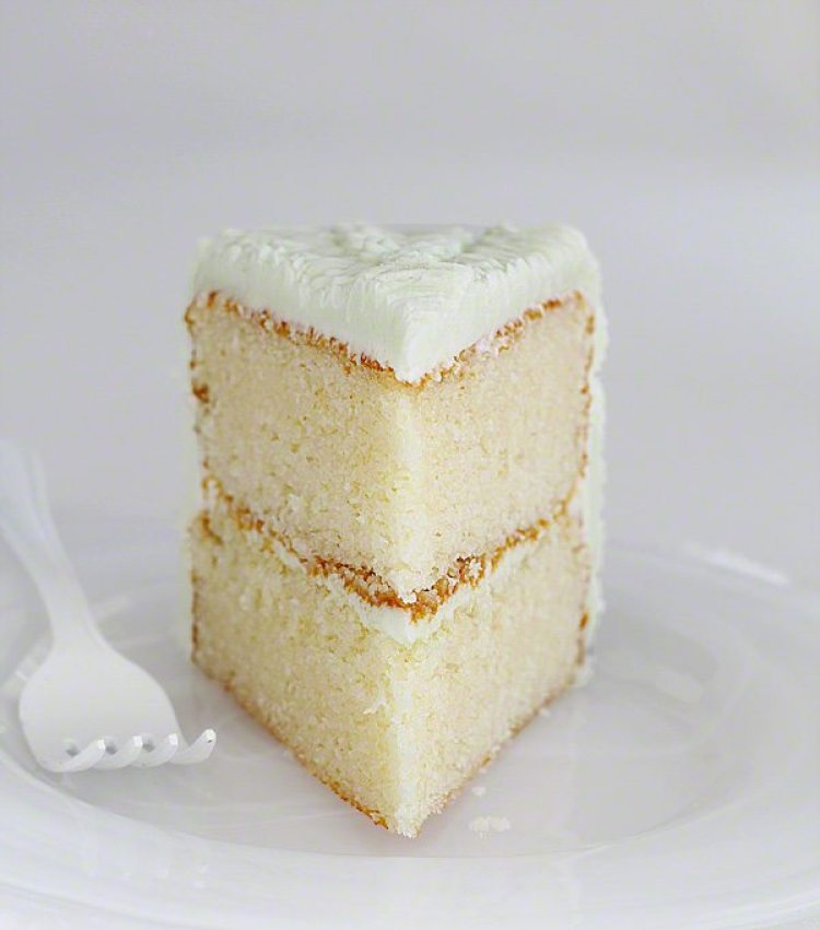 A slice of white cake on a plate
