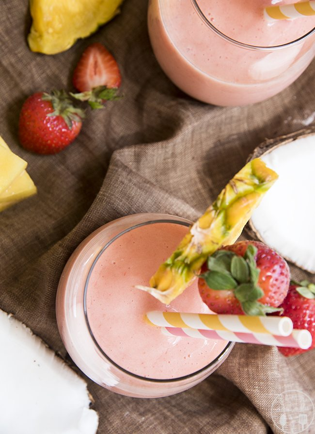 Strawberry Pina Colada Smoothie - This delicious smoothie is full of frozen pineapple, strawberries and cream of coconut for a perfectly refreshing and sweet drink, great for summer time!