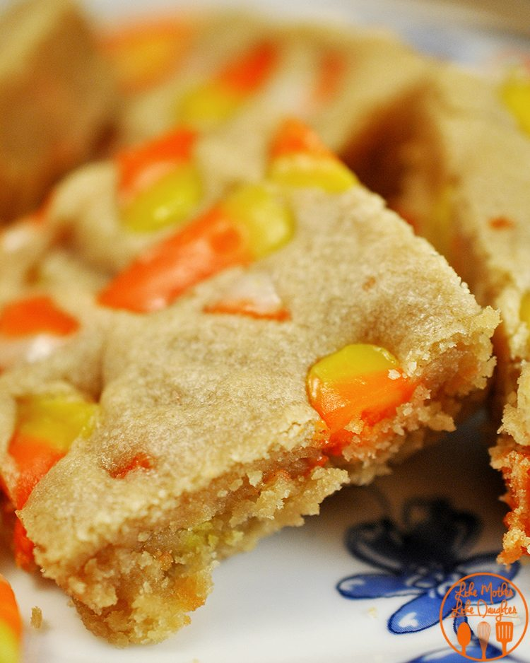 Candy Corn Peanut Butter Bars - If you love candy corn, and peanut butter you will love these delicious bars. They are super rich, so make sure to have them with a glass of milk!