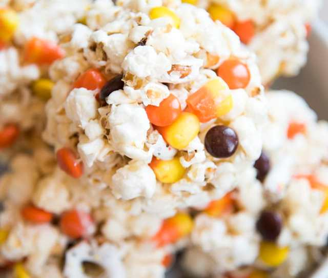 Halloween Popcorn Balls With Reeses Pieces Candy Corn And White Chocolate Pretzels