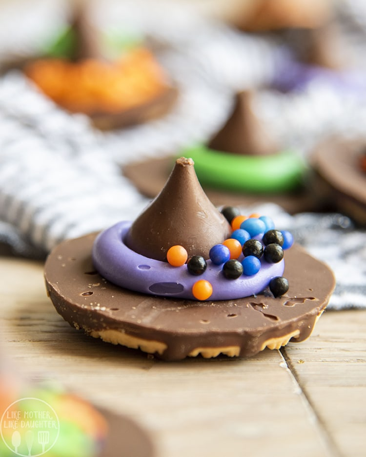 Fudge Stripe Cookies decorated with a hershey kiss to make witch hat cookies