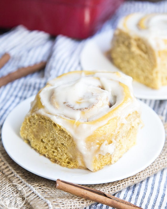 Pumpkin Cinnamon Rolls are the best fall breakfast, perfectly moist, with the perfect pumpkin flavor, stuffed full of cinnamon sugar and topped with a cream cheese frosting!