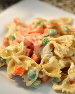 This vegetable pasta salad is tasty with colorful and crunchy vegetables dressed in a light mayo/mustard and fresh herb sauce.