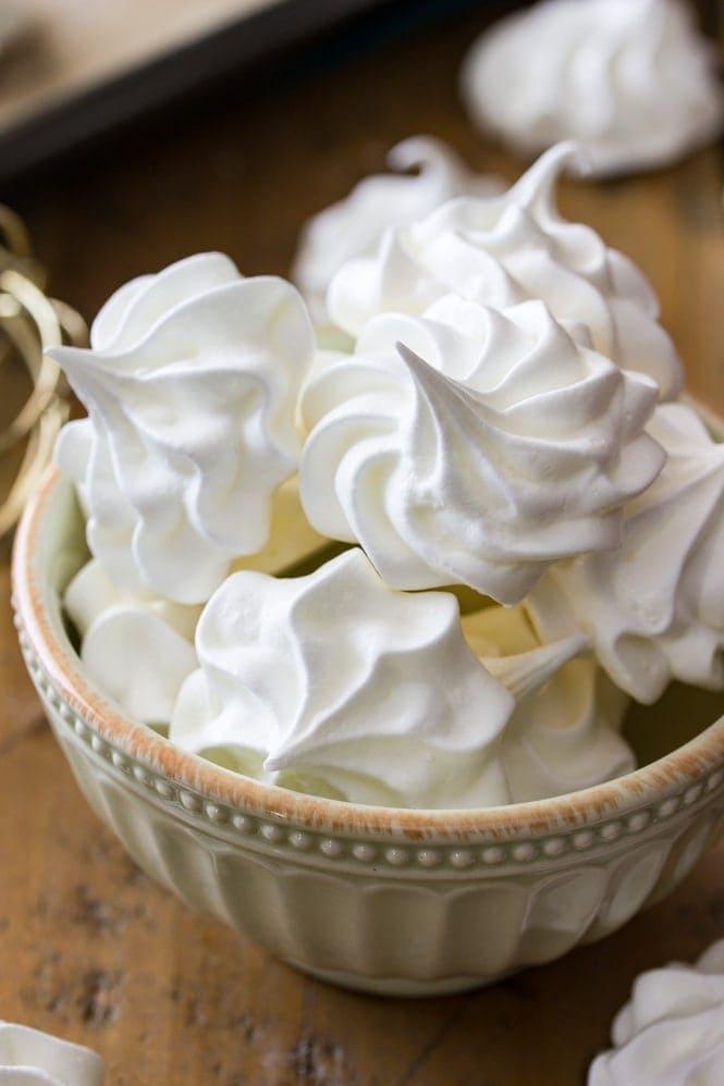 A bowl of white meringue cookies.