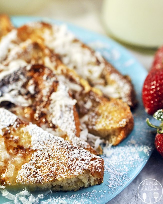 Coconut French Toast - this amazing coconut french toast brings a taste of the Hawaiian islands with French toast garnished by coconut flakes, powdered sugar and drenched in coconut syrup.