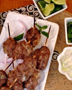Lamb Kebabs add a Middle Eastern flair to your dinner experiences. A robust flavor of lamb eaten in a pita, served with mint, red onions, and yogurt-cucumber dressing for easy hands on eating.
