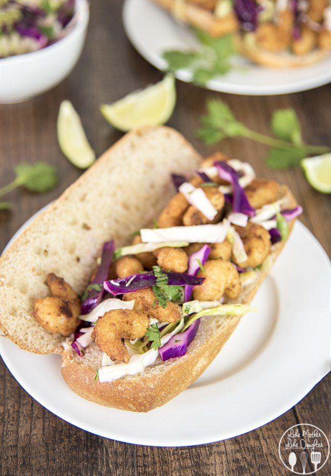 Shrimp Sandwich with Cilantro Lime Slaw - These simple to make sandwiches are ready in less than 30 minutes for a delicious and flavorful meal your family will love! The cilantro lime cabbage slaw is so flavorful!