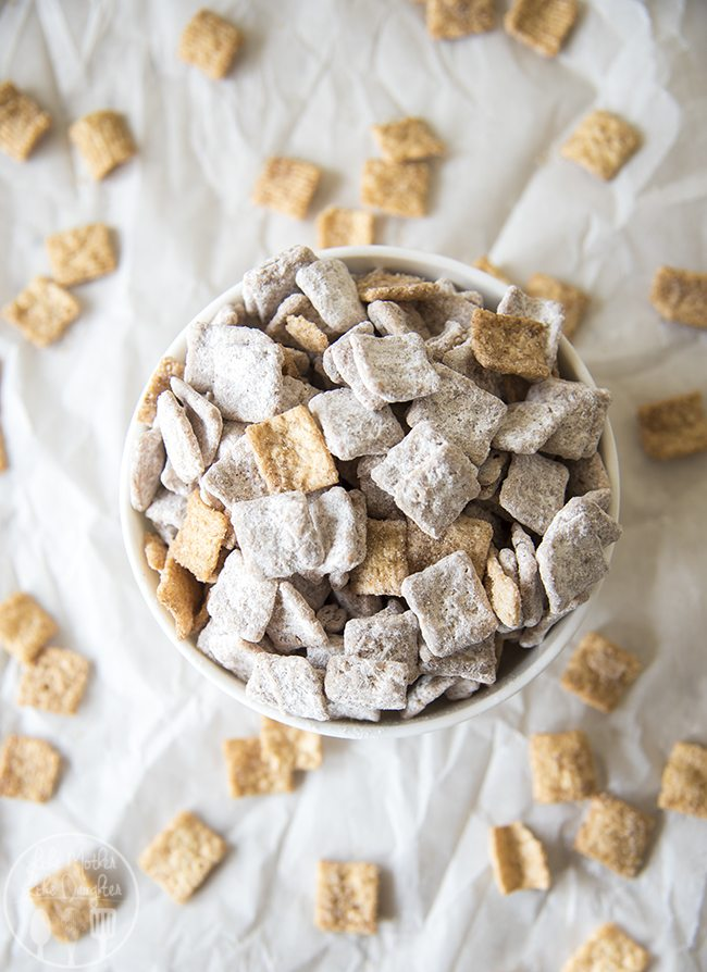 Snickerdoodle Muddy Buddies - a twist on traditional muddy buddies, this treat is made with cinnamon toast crunch cereal, coated in white chocolate then in powdered sugar and cinnamon. This is such a delicious and addicting snack!