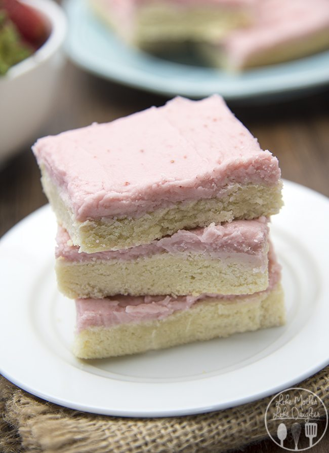 Strawberry Frosted Sugar Cookie Bars - These delicious sugar cookie bars are topped with an amazing creamy, rich, pink and fruity strawberry frosting! For an easy and delicious cookie bar!