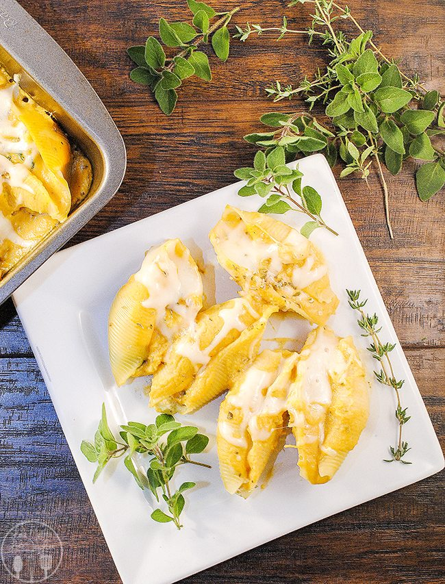 Butternut Sauce Ricotta Spinach Stuffed Shells - these stuffed shells have the goodness of roasted butternut squash sauce poured over cheesy spinach stuffed shells, all baked together for a delicious pasta dish.