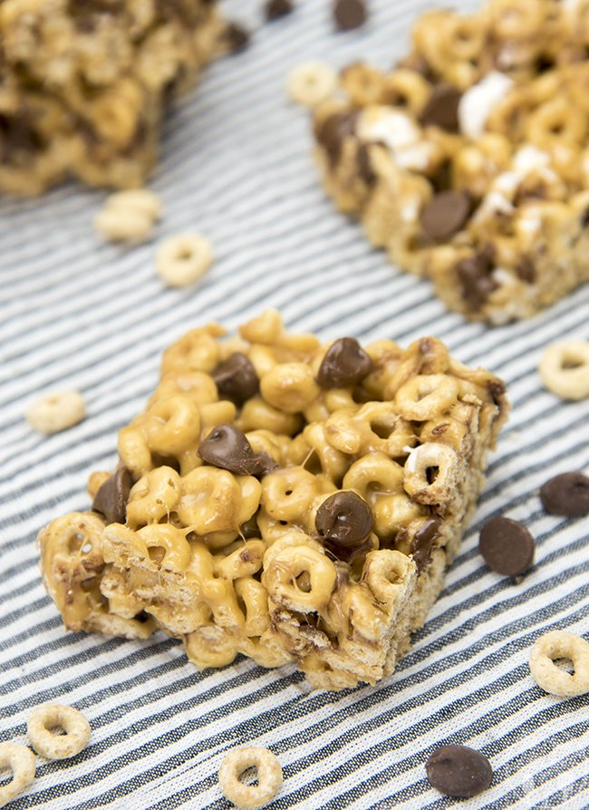 Chocolate Chip Fluffernutter Bars - These ooey gooey cereal bars are coated in a marshmallow peanut butter mixture and stuffed full of chocolate chips for a delicious treat!